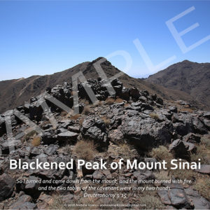 Blackened basalt rock summit of Mount Sinai in Arabia.