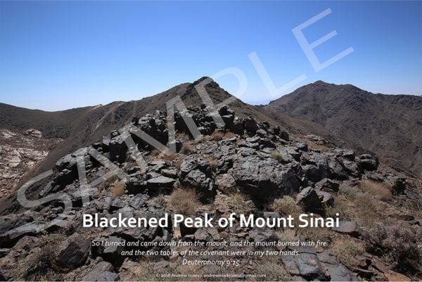 Blackened basalt rock summit of Mount Sinai in Arabia.